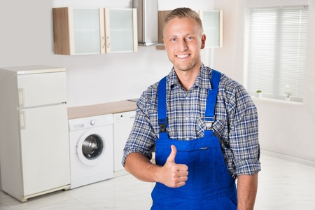 fridge repairman showing thumbs up sign