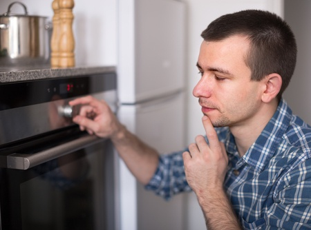 man thinking of oven issues