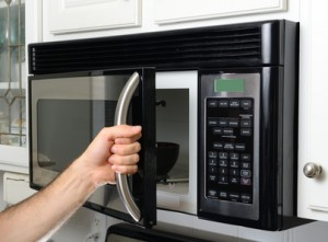 Over the range microwave oven service technician