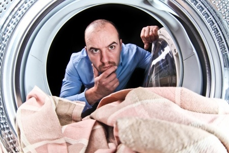 man checking dryer